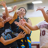Navajo Prep Eagle Lemaria Romaine (30) and Rehoboth Lynx Kennedi Chapman (40) and others compete for a rebound Friday at Rehoboth High School.