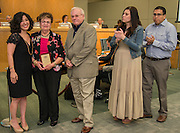 Juliet Stipeche, Elba Carrion and family pose for a photograph during the Houston ISD Board of Trustees meeting, May 14, 2015.