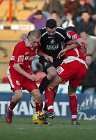 Photo: Ed Godden.<br />Bristol City v Swansea. Coca Cola League 1. 28/01/2006.<br />Swansea's Tom Williams (C) squeezes through the Bristol defence.