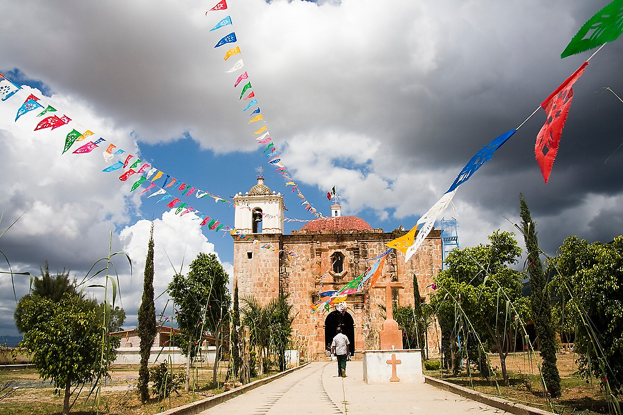 A man walks alone towards the small Spanish colonial church in the indigenous Zapotec village of Magdalena Teitipac, Oaxaca state, Mexico on July 22, 2008.