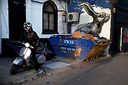 Roa is a Belgian street artist renowned for his giant black and white animals which can be found on walls and shutters in varying states of decay. Seen here is his famous hare character on Hackney Road. The council wanted to remove this piece but it has stayed due to public opinion. There are also a few Rats and Birds which reside on shop shutters along Brick Lane.<br /> <br /> Street art in the East End of London is an ever changing visual enigma, as the artworks constantly change, as councils clean some walls or new works go up in place of others. While some consider this vandalism or graffiti, these artworks are very popular among local people and visitors alike, as a sense of poignancy remains in the work, many of which have subtle messages.