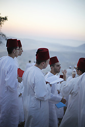 June 4, 2017 - Nablus, Palestine - Samaritans participate in a traditional ceremony celebrating the giving of the Torah on ''Shavuot festival'', atop Mount Gerizim near the West Bank city of Nablus. Shavuot Festival, known as the Feast of Weeks and as Pentecost in ancient Greek, is a Jewish holiday that occurs on the sixth day of the Hebrew month of Sivan. The Samaritan is a religious group that split from Judaism by the second century B.C.E. The Samaritans retained the Torah, the Five Books of Moses, as their Scripture. The Samaritan Bible refers to Mt. Gerizim, not Jerusalem, as the center of worship. (Credit Image: © Yunjie Liao/Pacific Press via ZUMA Wire)