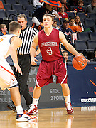 Nov 6, 2010; Charlottesville, VA, USA; Roanoke College g Ethan Humphries (4) dribbles the ball in front of Virginia Cavaliers g Billy Baron (15) Saturday afternoon in exhibition action at John Paul Jones Arena. The Virginia men's basketball team recorded an 82-50 victory over Roanoke College.