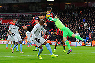Lukasz Fabianski (1) of West Ham United leapes from his goaline to punch the ball as Nathan Ake (5) of AFC Bournemouth heads the ball in to the goal but has thr goal ruled out during the Premier League match between Bournemouth and West Ham United at the Vitality Stadium, Bournemouth, England on 19 January 2019.