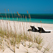 Lounge chairs on the beach at Grace Bay in Providenciales, Turks & Caicos