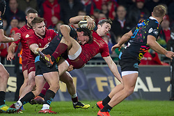 March 23, 2019 - Limerick, Ireland - Darren Sweetnam of Munster tackled by Tommaso Boni of Zebre during the Guinness PRO14 match between Munster Rugby and Zebre at Thomond Park Stadium in Limerick, Ireland on March 23, 2019  (Credit Image: © Andrew Surma/NurPhoto via ZUMA Press)