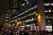 Architecture and commuters during rush hour in the City of London at night, England, United Kingdom. (photo by Mike Kemp/In Pictures via Getty Images)