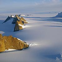 Mount Ulvetanna (R) & the Fenris Mountains tower over the Fenris Glacier.