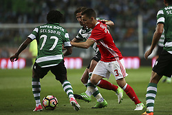 April 22, 2017 - Lisbon, Portugal - Benfica's Spanish defender Alex Grimaldo (R) vies with Sporting's forward Gelson Martins (L) and Sporting's midfielder Adrien Silva (2ndL) during the Portuguese League  football match between Sporting CP and SL Benfica at Jose Alvalade  Stadium in Lisbon on April 22, 2017. (Credit Image: © Carlos Costa/NurPhoto via ZUMA Press)