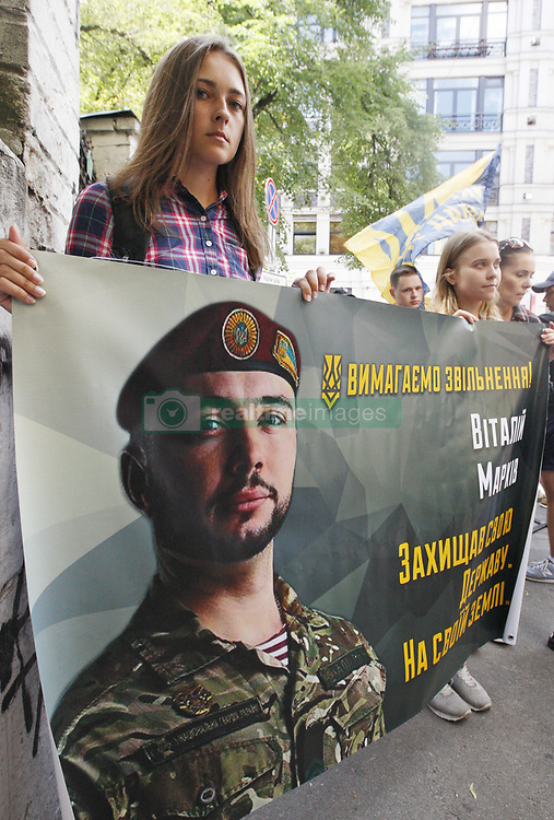 July 4, 2017 - Kiev, Ukraine - Ukrainian activists from National corps hold a poster with a portrait of Ukrainian soldier Vitaly Markiv, reading ''We demand liberation! He defended his state on his land'' during a protest against the detention Vitaly Markiv, in front the Embassy of Italy in Kiev, Ukraine, 4 July, 2017. Activists demand release of the Deputy commander of the battalion to them. Kulchytsky of the National Guard of Ukraine Vitaly Markiv , who was arrested in Italy on June 30, in suspicion of murdering an Italian journalist Andrea Rocchelli in the eastern Ukraine conflict zone near Slavyansk, on May 2014. (Credit Image: © Str/NurPhoto via ZUMA Press)