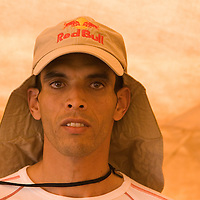 24 March 2007: 2006 winner Lahcen Ahansal of Morocco stands during a press conference the day before the beginning of the 22nd Marathon des Sables, a 6 days and 151 miles endurance race with food self sufficiency across the Sahara Desert in Morocco. Each participant must carry his, or her, own backpack containing food, sleeping gear and other material.