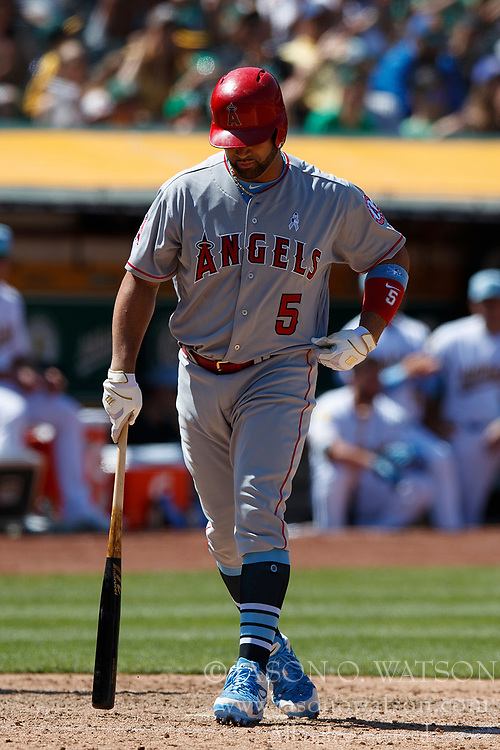 OAKLAND, CA - JUNE 17: Albert Pujols #5 of the Los Angeles Angels of Anaheim returns to the dugout after striking out against the Oakland Athletics during the ninth inning at the Oakland Coliseum on June 17, 2018 in Oakland, California. The Oakland Athletics defeated the Los Angeles Angels of Anaheim 6-5 in 11 innings. (Photo by Jason O. Watson/Getty Images) *** Local Caption *** Albert Pujols
