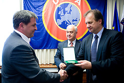 Award Plaketa NZS for year 2009 of Slovenian football federation (NZS) for Stanko Maticic of MNZ Maribor (L) given by president of NZS Ivan Simic, on May 7, 2009, in Hotel Kokra, Brdo at Kranj, Slovenia.  (Photo by Vid Ponikvar / Sportida)