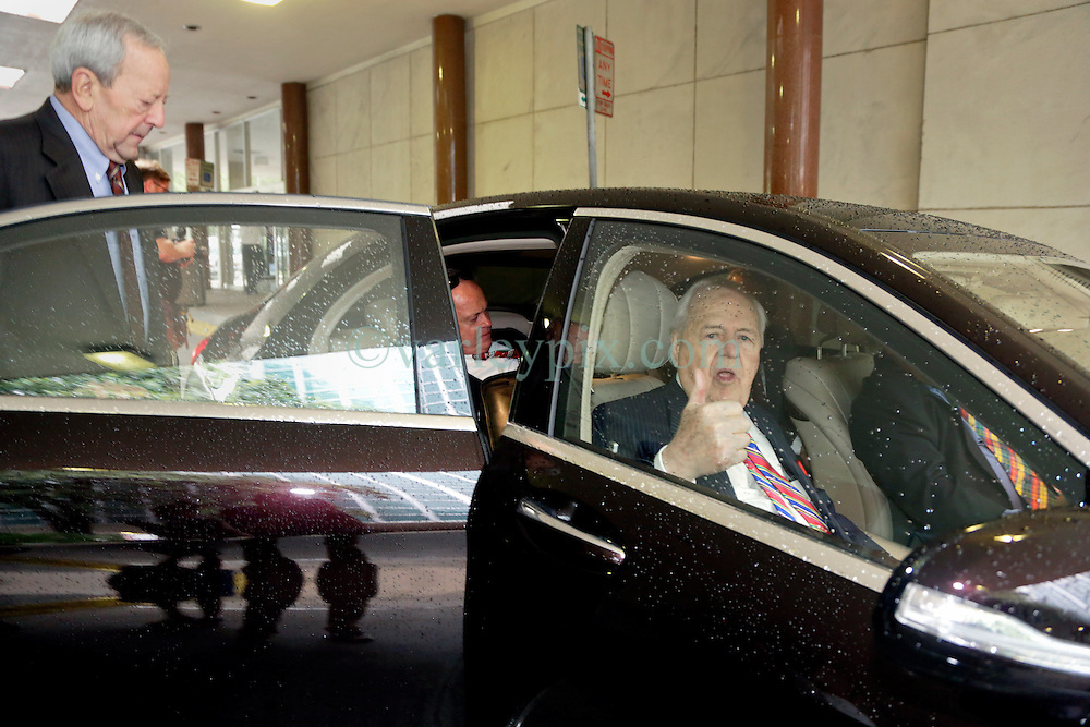 12 June  2015. New Orleans, Louisiana. <br /> Tom Benson (front seat), billionaire owner of the NFL New Orleans Saints, the NBA New Orleans Pelicans, various auto dealerships, banks, property assets and a slew of business interests leaves the New Orleans Civil District Court with his attorney Phillip Whitman where they are attending a hearing to determine Benson's level of competency to manage his business empire. Benson changed his succession plans and  decided to leave the bulk of his estate to third wife Gayle, sparking a controversial fight over control of the Benson business empire.<br /> Photo©; Charlie Varley/varleypix.com