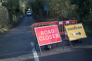 Road closed signs after storm damage tree fallen blocking road, Hollesley, Suffolk, England, UK
