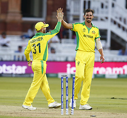 June 29, 2019 - London, United Kingdom - Mitchell Starc of Australia blows out Lockie Ferguson of New Zealand.during ICC Cricket World Cup between New Zealand and Australia at the Lord's Ground on 29 June 2019 in London, England. (Credit Image: © Action Foto Sport/NurPhoto via ZUMA Press)