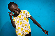 A child imitates a photo pose of his favourite singer before a community commemoration organized by UNPOL and South Sudan Police in the Yei Checkpoint near nº 3 IDP camp (Internal Displacement People), Juba, South Sudan, 9 January 2021.<br /> Photo UN/Gregorio Cunha