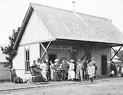 "9534-18A. ""Ocean Park. 1912."" Train Depot ""Ocean Park"" sign and crowd awaiting train. Washington state."
