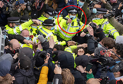 © Licensed to London News Pictures. 03/04/2021. London, UK. A police officer uses pepper spray (circled in red) as scuffles break out in Parliament Square during a Kill the Bill demonstration in central London. A coalition of groups including Extinction Rebellion, Kill the Bill & Black Lives Matter are coming together over the Easter weekend to campaign against the proposed Police, Crime, Sentencing and Courts Bill which will give police in England and Wales more power to impose conditions on non-violent protests. Photo credit: Peter Macdiarmid/LNP