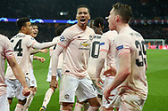 Manchester United Defender Chris Smalling celebrates after the match with fans during the Champions League Round of 16 2nd leg match between Paris Saint-Germain and Manchester United at Parc des Princes, Paris, France on 6 March 2019.
