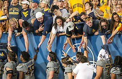 Sep 11, 2021; Morgantown, West Virginia, USA; West Virginia Mountaineers players celebrate with fans after defeating the Long Island Sharks at Mountaineer Field at Milan Puskar Stadium. Mandatory Credit: Ben Queen-USA TODAY Sports