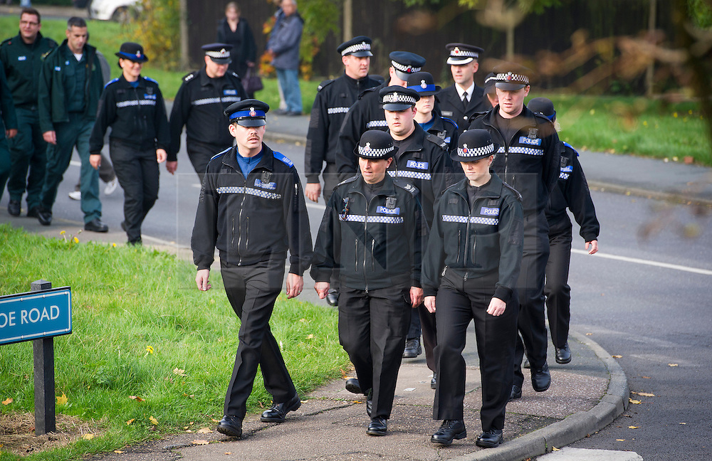 © London News Pictures. 24/10/2012. Harlow, UK.  Members of the police Service leaving the funeral service of Dr Sabah Usmani and her five children Hira (12), Sohaib (11) Muneeb (9), Rayyan (6) and Maheen (3) at Harlow Islamic Centre in Harlow, Essex, UK on October 24, 2012. Dr Sabah Usmani and her five children died blaze at their home in Harlow last week. Photo credit: Ben Cawthra/LNP