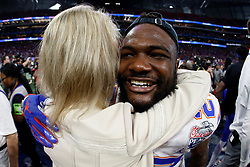 Florida Gators defensive back Quincy Lenton #27 celebrates with Megan Mullen after winning the Chick-fil-A Peach Bowl, Saturday, December 29, 2018, in Atlanta. ( Paul Abell via Abell Images for Chick-fil-A Peach Bowl)