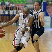 Efes Pilsen's Charles SMITH (L) and Besiktas's Muratcan GULER (R) during their Turkish Basketball league Play Off semi final first match Efes Pilsen between Besiktas at the Ayhan Sahenk Arena in Istanbul Turkey on Sunday 09 May 2010. Photo by Aykut AKICI/TURKPIX