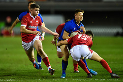 Steve Varney of Italy is tackled by Josh Thomas of Wales <br /> <br /> Photographer Craig Thomas/Replay Images<br /> <br /> U20 Six Nations - Wales v Italy  - Friday 31st January 2020 - Stadiwm Zip World (Parc Eirias) - Colwyn Bay<br /> <br /> World Copyright © Replay Images . All rights reserved. info@replayimages.co.uk - http://replayimages.co.uk