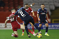 Aberdeen forward Marley Watkins (50) tackles Hamilton Academicals Hakeem Odoffin (2) during the Scottish Premiership match between Aberdeen and Hamilton Academical FC at Pittodrie Stadium, Aberdeen, Scotland on 20 October 2020.