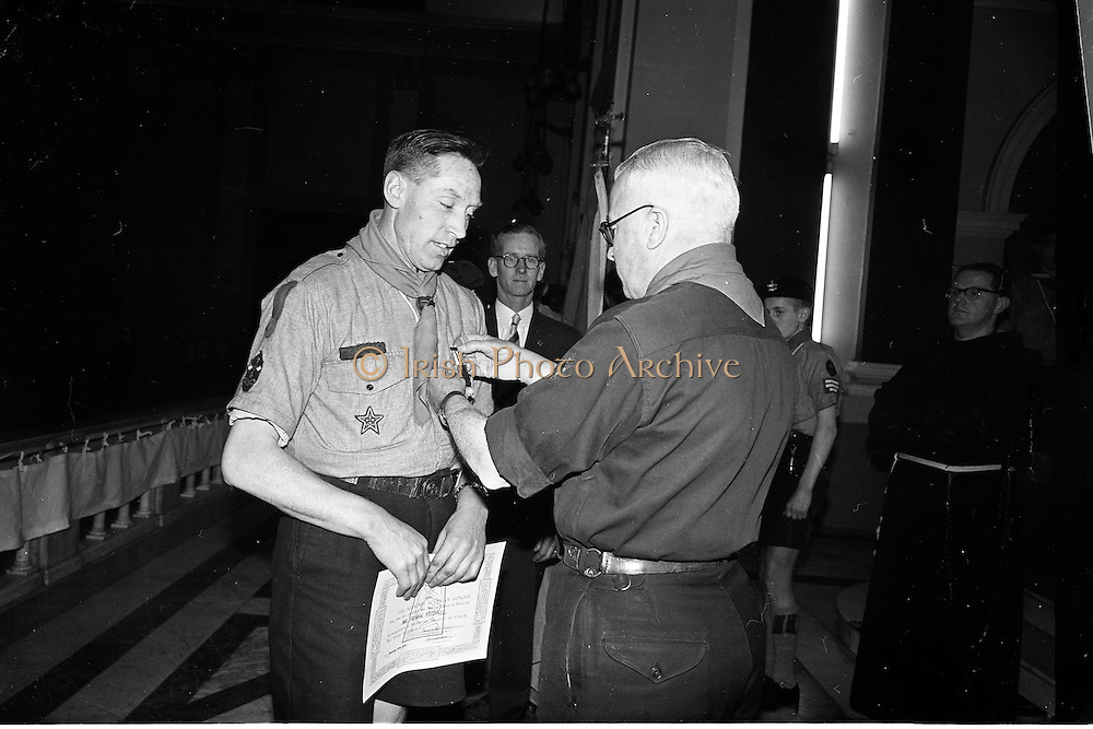 20/01/1963<br /> 01/20/1963<br /> 20 January 1963<br /> CBSI Investiture at Merchants Quay, Dublin. Investiture of 52 Scouts and 30 Macoimh, and presentation of 4 commissions to Scout Masters at the Franciscan Church. Image shows Chief Scout, Mr C.J. Murphy (right) pinning the Bronze medal of the Catholic Boy Scouts of Ireland on Francis Tisdall of the Franciscan Unit of the Scouts at the ceremony.