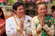 Mar. 14, 2009 -- LUANG PRABANG, LAOS: A newly wed couple greets guests at their wedding reception north of Luang Prabang, Laos. Photo by Jack Kurtz / ZUMA Press
