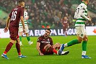 Andrei Burca left on the ground during the Europa League match between Celtic and CFR Cluj at Celtic Park, Glasgow, Scotland on 3 October 2019.
