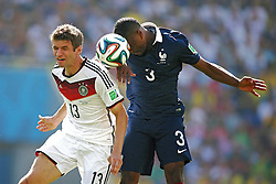 04.07.2014, Maracana, Rio de Janeiro, BRA, FIFA WM, Frankreich vs Deutschland, Viertelfinale, im Bild Thomas Mueller from Germany fights for the ball against Patrice Evra from France // during quarterfinals between France and Germany of the FIFA Worldcup Brazil 2014 at the Maracana in Rio de Janeiro, Brazil on 2014/07/04. EXPA Pictures © 2014, PhotoCredit: EXPA/ Eibner-Pressefoto/ Cezaro<br /> <br /> *****ATTENTION - OUT of GER*****