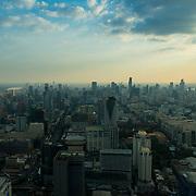 Bangkok panorama from Baiyoke tower at dusk with many skyscrapers in the horizon