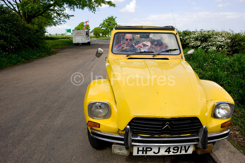 A couple picnic in their Citroën CV parked near a burger van in a rural layby on the 09th May 2011 near Newcastle in the United Kingdom.