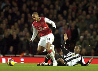 Photo: Olly Greenwood.<br />Arsenal v Newcastle United. The Barclays Premiership. 18/11/2006. Arsenal's Thierry Henry fouls Newcastle's Titus Bramble