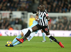27 December 2017 Newcastle: Premier League Football - Newcastle United v Manchester City : Nicolas Otamendi of City slips as he is tackled by Mohamed Diame.<br /> (photo by Mark Leech)