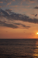 Orange colored sky and clouds over the Pacific Ocean just after sunrise. Image 4 of 10 for a wide-angle panorama taken with a Fuji X-T1 camera and 35 mm f/1.4 lens  (ISO 200, 35 mm, f/16, 1/250 sec). Raw images processed with Capture One Pro and stitched together with AutoPano Giga Pro.
