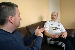 A Care worker communicates with a deaf man using sign language in a Housing Association Sheltered House; York,