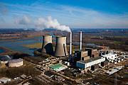 Nederland, Limburg, Gemeente Maasgouw, 07-03-2010; Maasbracht, Prins Clauscentrale, elektriciteitscentrale van Essent gelegen aan de Maas, werkt voornamelijk op aardgas. Levert ook groene stroom waarvoor de centrale gestookt wordt met plantaardige olie. De centrale wordt gekoeld met behulp van de monumentale koeltorens en/of rivierwater. De centrale wordt momenteel uitgebreid, met een STEG-eenheid (stoom- en gasturbine). Aan de horizon Roermond.<br /> Maasbracht, Prins Claus power plant (Essent) situated on the Maas, working primarily on natural gas. The plant can also supply green electricity if fueled with vegetable oil. The plant is either cooled by the monumental cooling towers and / or river water.<br /> luchtfoto (toeslag), aerial photo (additional fee required);<br /> foto/photo Siebe Swart