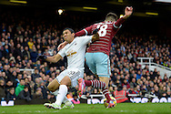 Carl Jenkinson of West Ham United breaks away from Jefferson Montero of Swansea City. Barclays Premier league match, West Ham Utd v Swansea city at the Boleyn ground, Upton Park in London on Sunday 7th December 2014.<br /> pic by John Patrick Fletcher, Andrew Orchard sports photography.