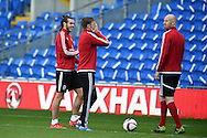 Gareth Bale of Wales (l), Aaron Ramsey © and James Collins of Wales ® share a joke during Wales football team training session at the Cardiff city stadium  in Cardiff, South Wales  on Monday 12th October 2015. The team are training ahead of their final Euro 2016 qualifying against Andorra tomorrow.<br /> pic by  Andrew Orchard, Andrew Orchard sports photography.