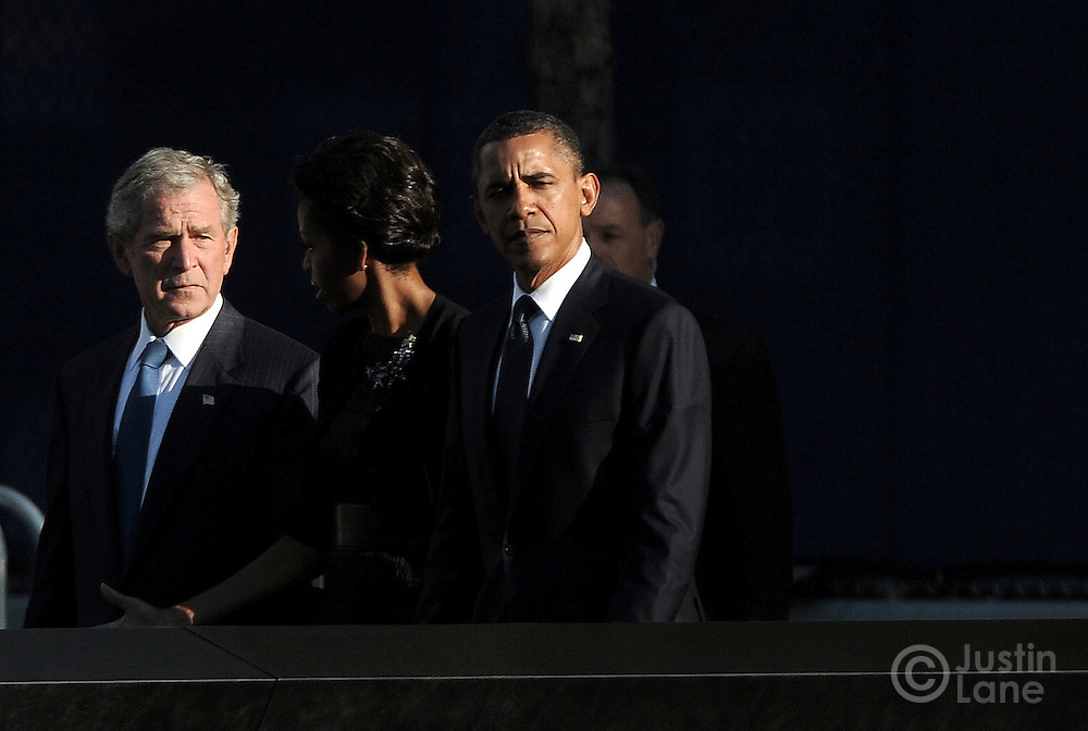 United States President Barak Obama (R), first Lady Michelle Obama (2nd R) and former President George W. Bush (L) walk past the North Pool of the 9/11 Memorial during tenth anniversary ceremonies at the site of the World Trade Center September 11, 2011, in New York. POOL/Justin Lane/EPA
