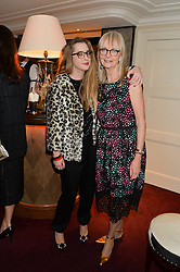 Left to right, DAISY DE VILLENEUVE and JAN DE VILLENEUVE at a dinner hosted by fashion label Kate Spade NY held at George, 87-88 Mount Street, London on 19th November 2014.