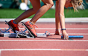 A relay participant gets set before the race begins during the second day of the state high school track and field meet Saturday, May 25, 2019, at Howard Wood Field in Sioux Falls.