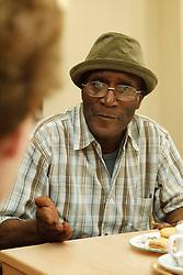 Elderly man in conversation.
