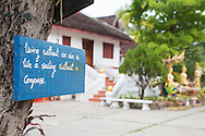 """Living without an aim is like sailing without a compass"" reads the saying on one of the many inspirational signs posted at Wat May in Luang Prabang, Laos."
