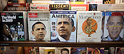 A row of magazines featuring cover images of Barack Obama in a bookstore in New York.