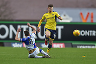 Oxford United Midfielder, Josh Ruffels (14) skips a challenge by Bristol Rovers Midfielder, Ollie Clarke (8) during the EFL Sky Bet League 1 match between Oxford United and Bristol Rovers at the Kassam Stadium, Oxford, England on 10 February 2018. Picture by Adam Rivers.